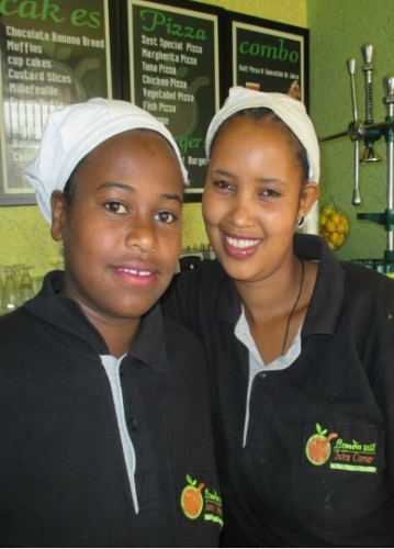 raduates of Vulnerable Children Society's teen program, working in a restaurant